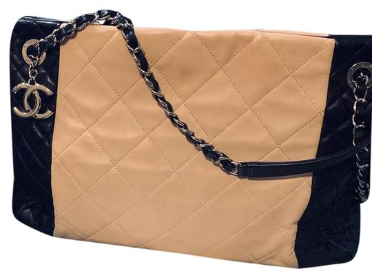 Preload https://img-static.tradesy.com/item/25431974/chanel-shopping-description-timeless-beige-and-black-lambskin-leather-tote-0-1-540-540.jpg