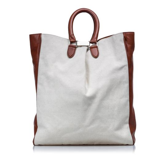 Preload https://img-static.tradesy.com/item/25434199/ivory-fabric-france-white-canvas-leather-tote-0-0-540-540.jpg