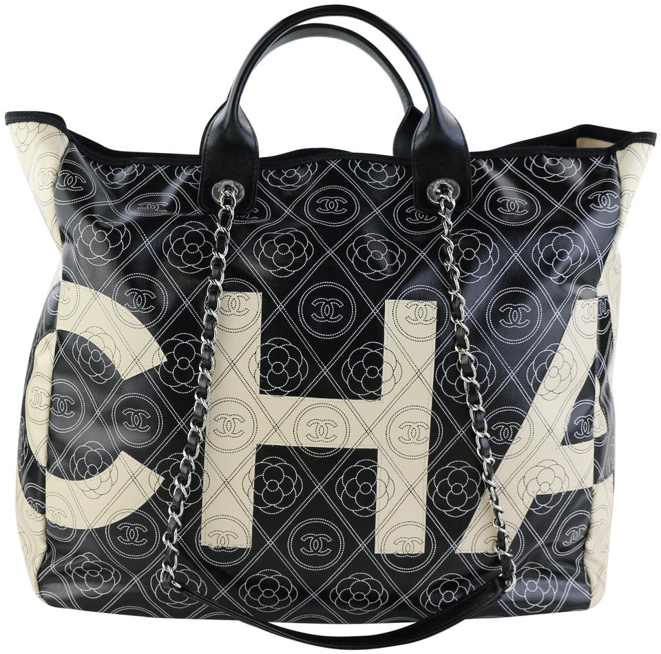 aa1846327f72 Chanel Camellia Camellia Spring 2018 Coated Canvas Tote in Black/White  Image 0 ...