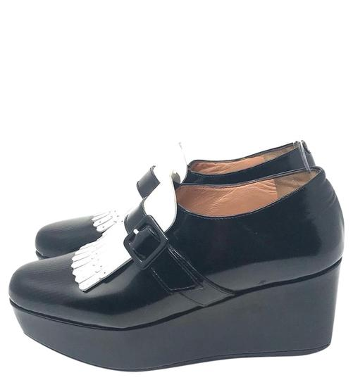Preload https://img-static.tradesy.com/item/25461061/robert-clergerie-kiltie-platform-wedges-size-us-7-regular-m-b-0-1-540-540.jpg