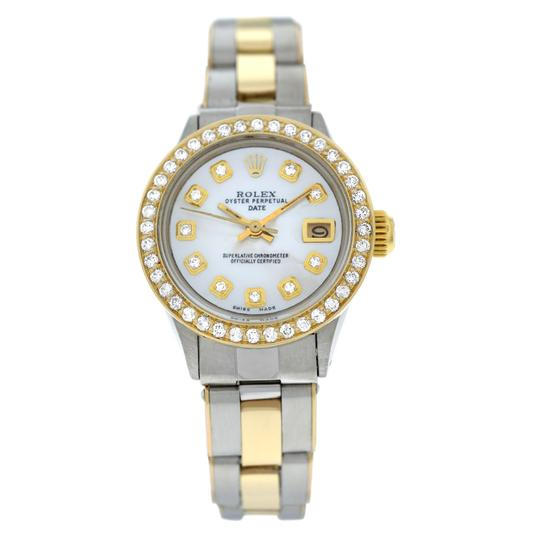 Preload https://img-static.tradesy.com/item/25462064/rolex-yellow-gold-silver-ladies-oyster-perpetual-date-6517-steel-and-diamond-mop-26mm-watch-0-0-540-540.jpg