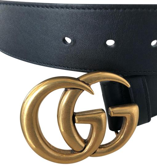 Preload https://img-static.tradesy.com/item/25463364/gucci-black-and-gold-leather-with-double-g-buckle-belt-0-1-540-540.jpg