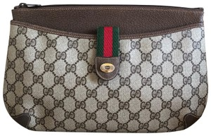 4ffa92d3f7999e Gucci Vintage Accessory Collection Monogram Leather Ophidia Brown Clutch