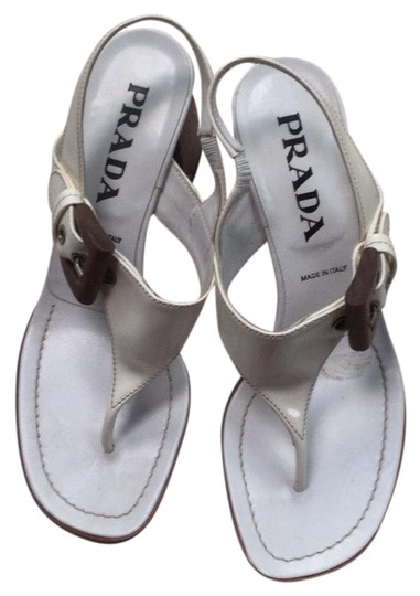 Preload https://img-static.tradesy.com/item/25472826/prada-white-chucks-heal-sandals-size-eu-375-approx-us-75-regular-m-b-0-1-540-540.jpg