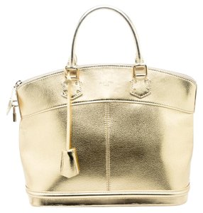 Louis Vuitton Leather Nylon Tote in Gold