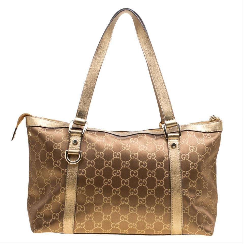215351df1 Gucci Abbey Brown/Gold Gg Fabric Medium Gold Leather Tote - Tradesy