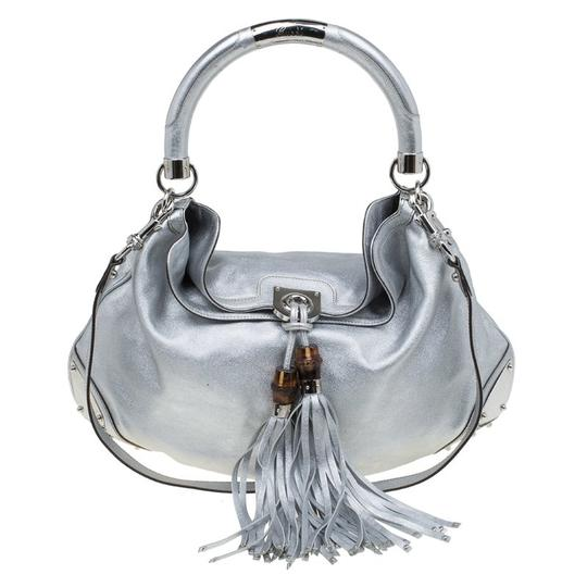 Preload https://img-static.tradesy.com/item/25481852/gucci-indy-large-top-handle-silver-leather-hobo-bag-0-0-540-540.jpg