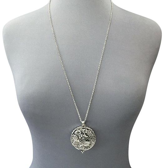 Preload https://img-static.tradesy.com/item/25482146/silver-finish-chain-butterfly-sunflower-5x-magnifying-glass-necklace-0-1-540-540.jpg