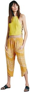 Free People Harem Style Cropped Sits Below The Waist Pleated Detail Dropped Crotch Capris Marigold