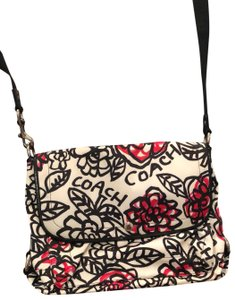 Coach Black/White with some pink flowers. Messenger Bag