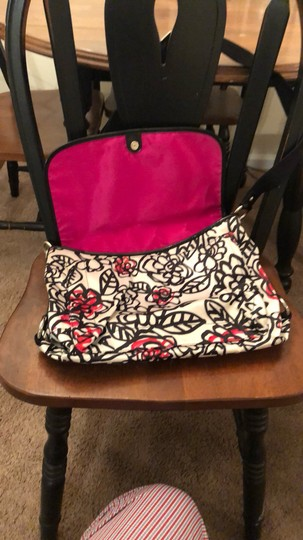 Coach Black/White with some pink flowers. Messenger Bag Image 1