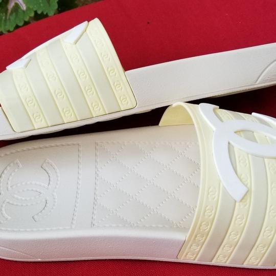 Chanel pool slippers Size white / yellow / tan Sandals Image 1