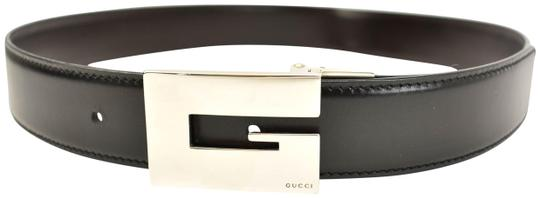 Preload https://img-static.tradesy.com/item/25488868/gucci-blackbrown-reversible-leather-and-g-logo-fits-27-to-29-om-belt-0-1-540-540.jpg
