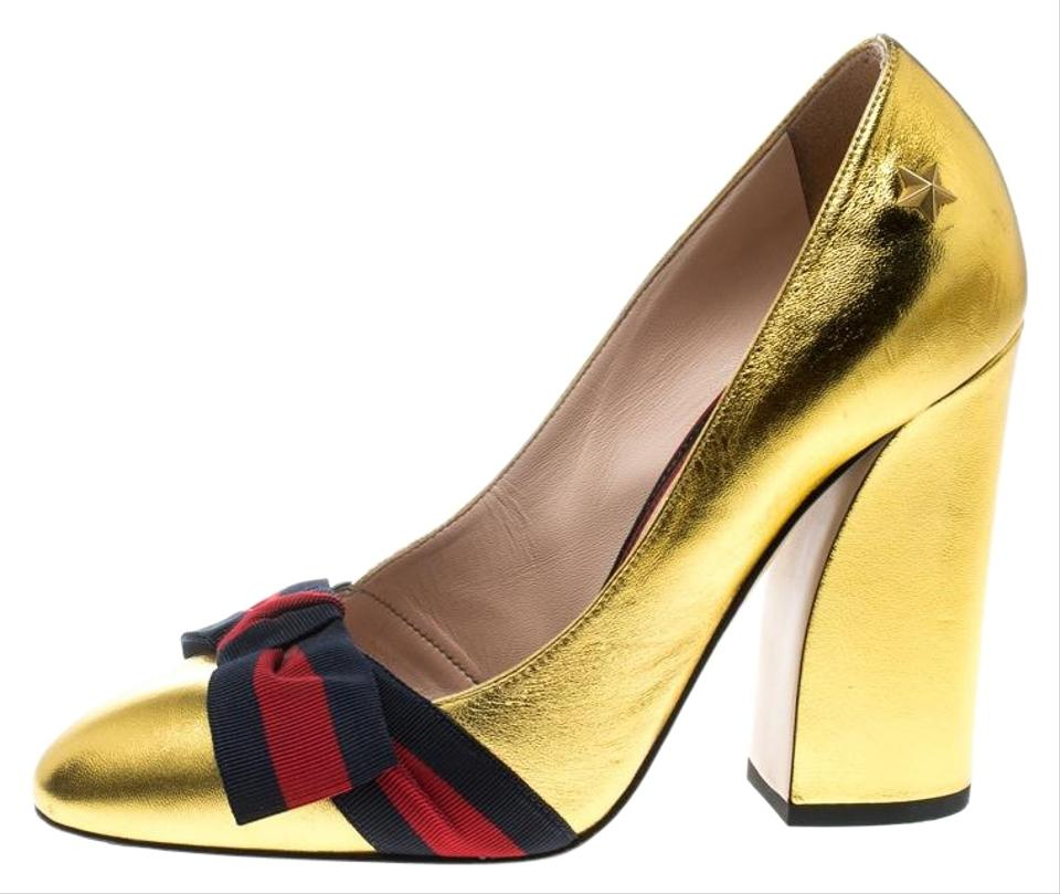 257c08ae1 Gucci Gold Metallic Leather Web Bow Detail Pumps. Size: EU 37.5 (Approx. US  7.5) Regular ...