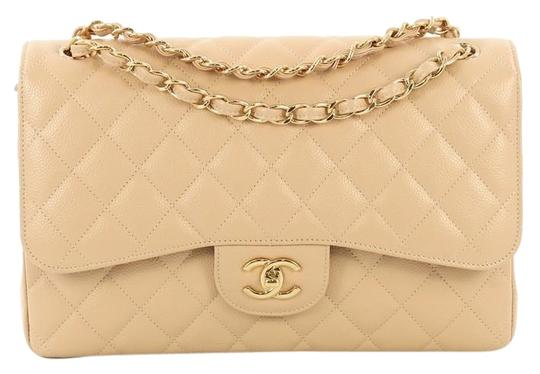Preload https://img-static.tradesy.com/item/25489483/chanel-classic-flap-classic-double-quilted-caviar-jumbo-beige-leather-cross-body-bag-0-1-540-540.jpg