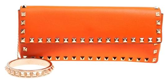 Preload https://img-static.tradesy.com/item/25493842/valentino-neon-rockstud-bangle-orange-leather-clutch-0-1-540-540.jpg