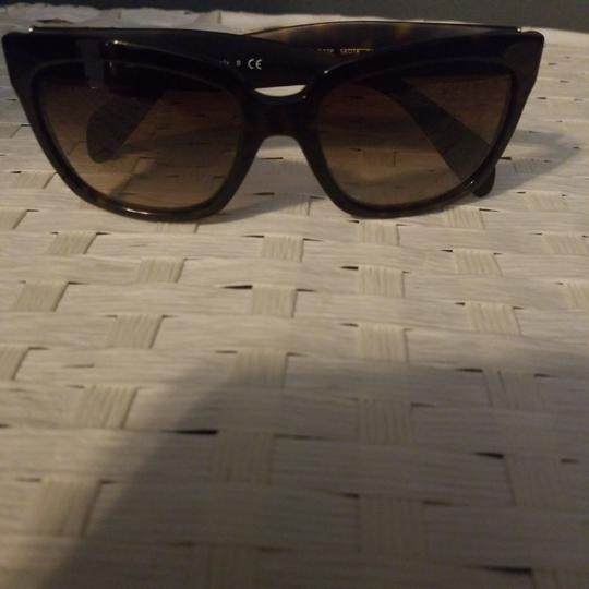 Preload https://img-static.tradesy.com/item/25496716/prada-brown-sunglasses-0-4-540-540.jpg