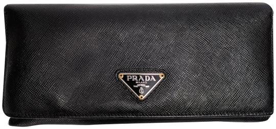 Preload https://img-static.tradesy.com/item/25496899/prada-black-nero-saffiano-metal-continental-wallet-0-1-540-540.jpg