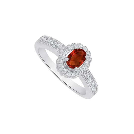 Preload https://img-static.tradesy.com/item/25499674/red-garnet-and-cz-halo-engagement-in-14k-white-gold-ring-0-0-540-540.jpg