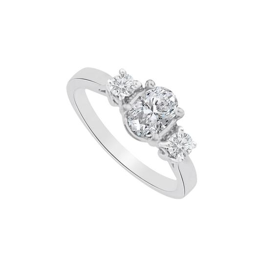 Preload https://img-static.tradesy.com/item/25499908/white-cubic-zirconia-three-stones-in-14k-gold-ring-0-0-540-540.jpg