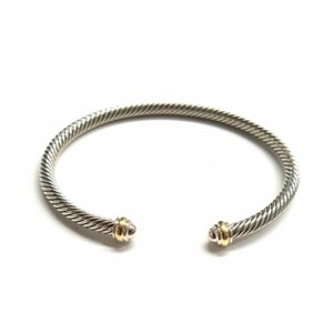 "David Yurman GORGEOUS!! LIKE NEW!! David Yurman 18 Karat Yellow Gold and Sterling Silver Cable Classic 4mm Bracelet Cuff 18 Karat Yellow Gold Sterling Silver 4mm Size: 6.75"" Flexible sizing 100% Authentic Guaranteed!! Comes with Original David Yurman Pouch!!!"