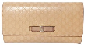 Gucci Gucci guccissima salmon leather embossed snap long wallet