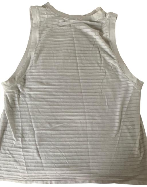 Preload https://img-static.tradesy.com/item/25515531/lululemon-white-workout-tank-topcami-size-8-m-0-1-650-650.jpg