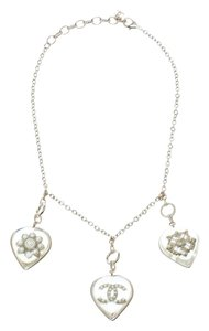Chanel CC Aged Gold Tone Metal Motif Embedded Heart Pendants Necklace