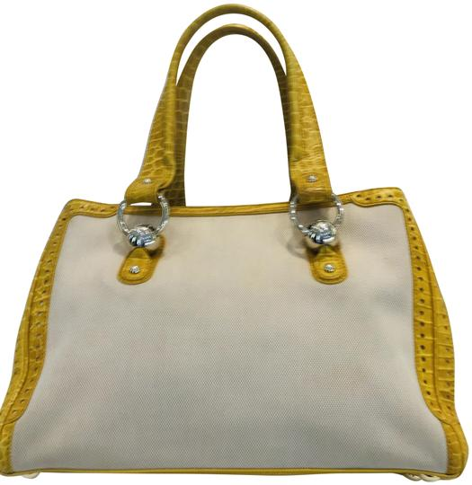 Preload https://img-static.tradesy.com/item/25522740/celine-crocodile-embossed-leather-and-yellow-canvas-tote-0-3-540-540.jpg