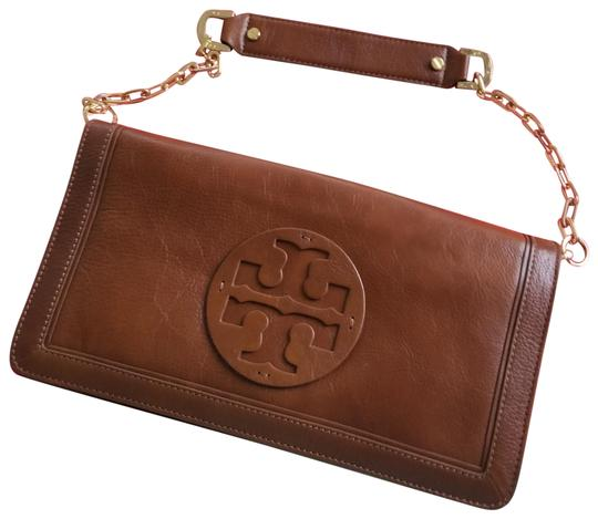 Preload https://img-static.tradesy.com/item/25523531/tory-burch-reva-aged-camello-leather-clutch-0-2-540-540.jpg