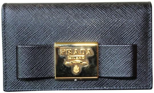 Preload https://img-static.tradesy.com/item/25534700/prada-black-saffiano-leather-with-bow-wallet-0-2-540-540.jpg