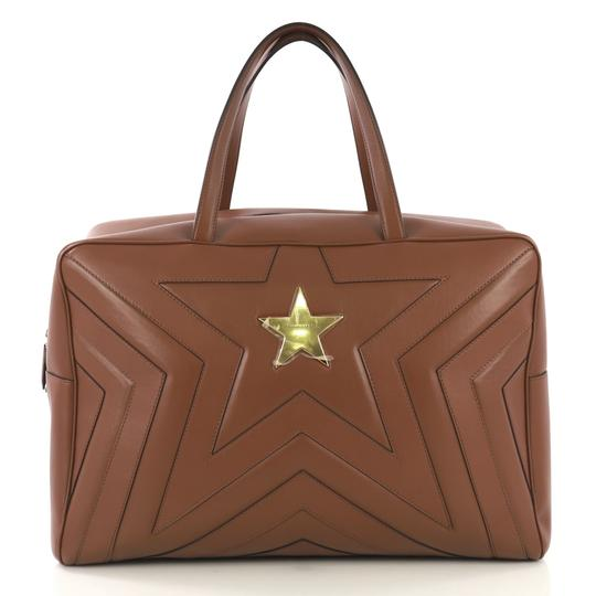 Preload https://img-static.tradesy.com/item/25537632/stella-mccartney-duffle-star-overnight-quilted-faux-brown-leather-weekendtravel-bag-0-0-540-540.jpg