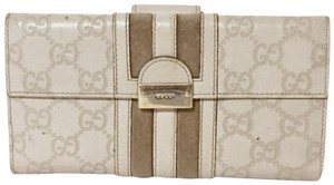 Gucci Gucci leather embossed monogram strip long snap wallet