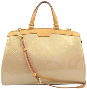 Louis Vuitton Lv Brea Mm Vernis Satchel in Gold