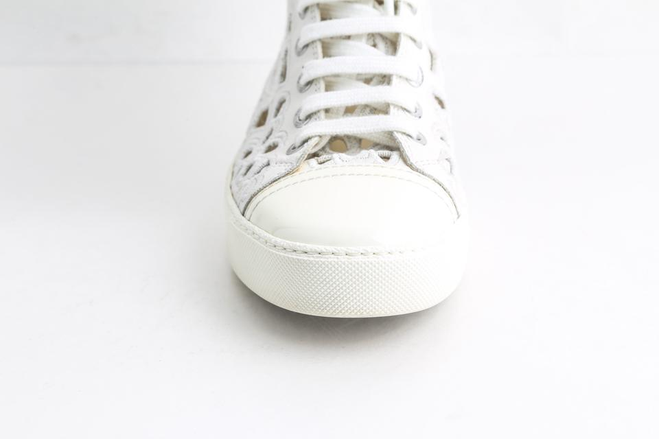 newest 76505 f3bc3 Chanel White 14s High Top Round Toe Camelia Laser Cut Sneakers Size US 5  Regular (M, B) 42% off retail
