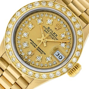 Rolex Ladies Datejust 18k Yellow Gold with String Diamond Dial Watch