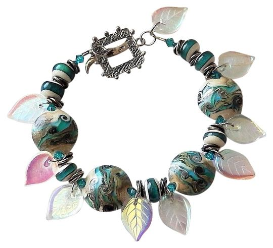 Preload https://img-static.tradesy.com/item/25552787/teal-sterling-lampwork-czech-glass-and-adorned-wswarovski-crystals-bracelet-0-1-540-540.jpg