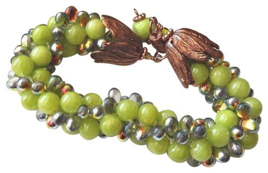 Preload https://img-static.tradesy.com/item/25552863/lime-copper-and-glass-beaded-magnetic-plus-size-bracelet-0-1-540-540.jpg