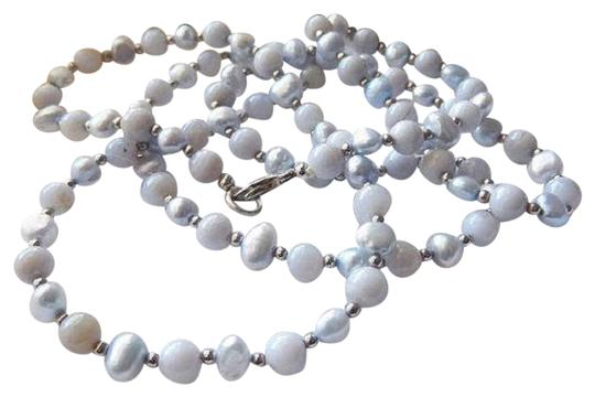 Preload https://img-static.tradesy.com/item/25553156/long-sterling-silver-blue-freshwater-pearl-and-chalcedony-necklace-0-1-540-540.jpg