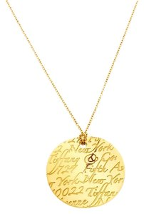 cd0781906 Tiffany & Co. Tiffany Notes Engraved 18k Yellow Gold Round Wave Pendant  Necklace