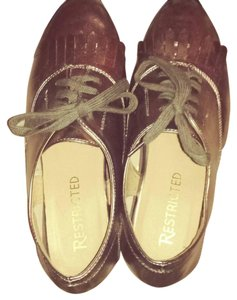 Restricted Bronze Flats