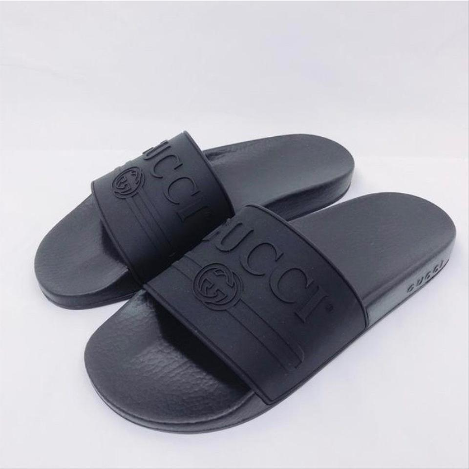 b709ab00a Gucci Logo Embossed Rubber Slides Sandals Size EU 37 (Approx. US 7) Regular  (M, B) - Tradesy
