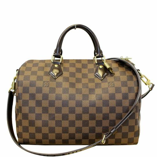 Preload https://img-static.tradesy.com/item/25572057/louis-vuitton-shoulder-bag-speedy-30-bandouliere-brown-damier-ebene-canvas-satchel-0-0-540-540.jpg