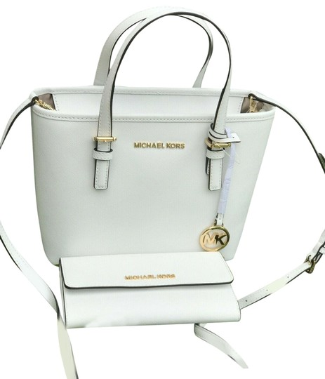 Preload https://img-static.tradesy.com/item/25576506/michael-kors-xs-jet-set-travel-and-wallet-set-in-optic-white-leather-tote-0-1-540-540.jpg
