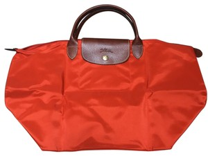 Longchamp Orange Travel Bag