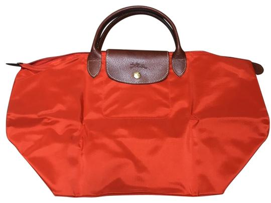 Preload https://img-static.tradesy.com/item/25577242/longchamp-orange-nylon-weekendtravel-bag-0-1-540-540.jpg