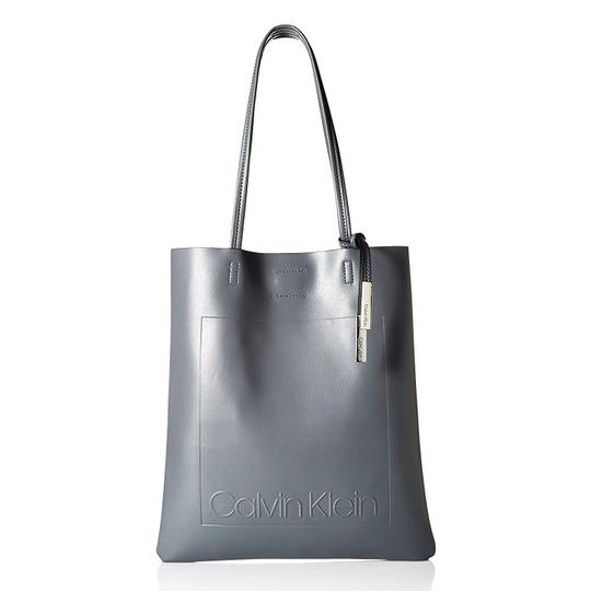 Preload https://img-static.tradesy.com/item/25577391/calvin-klein-bag-nora-novelty-northsouth-magazine-grey-faux-leather-tote-0-0-540-540.jpg