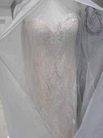 Preload https://img-static.tradesy.com/item/25586597/maggie-sottero-ivory-with-soft-blush-tulle-autumn-formal-wedding-dress-size-14-l-0-1-540-540.jpg