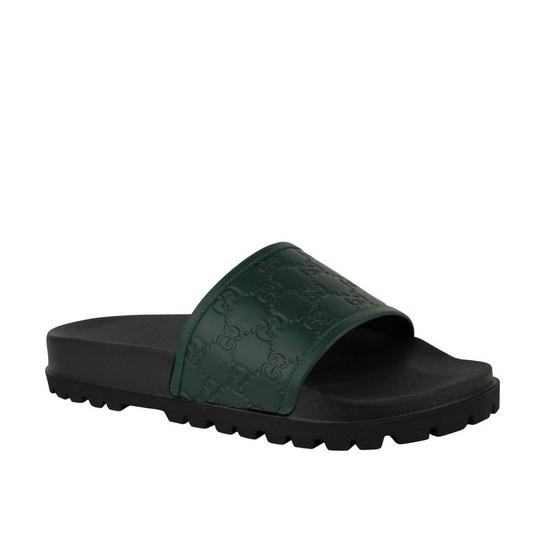 Preload https://img-static.tradesy.com/item/25587144/gucci-green-black-guccissima-pattern-leather-sandals-431070-3020-groomsman-gift-0-0-540-540.jpg