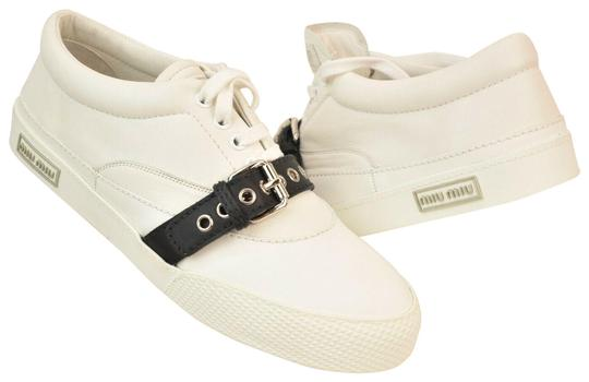 Preload https://img-static.tradesy.com/item/25587440/miu-miu-white-leather-black-belted-buckle-logo-lace-up-low-sneakers-size-eu-41-approx-us-11-regular-0-1-540-540.jpg